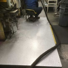 Metal floor cleaning after