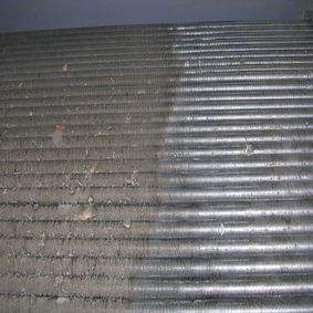 Heat exchanger fin tube cleaning
