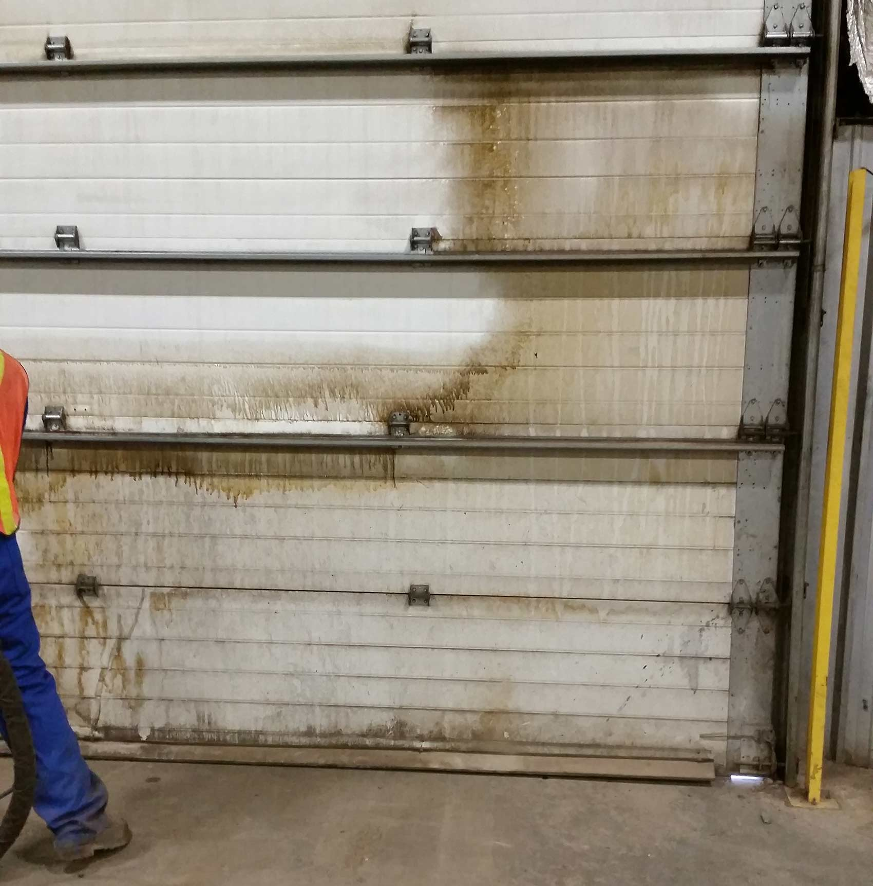 Industrial garage door cleaning