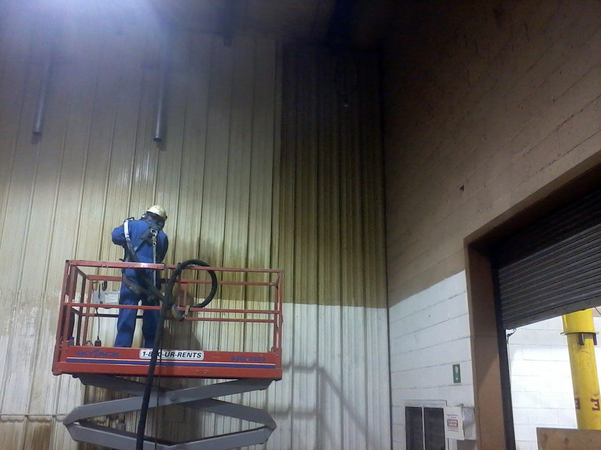 Removal of oil and welding smoke residue from metal walls in machine shop
