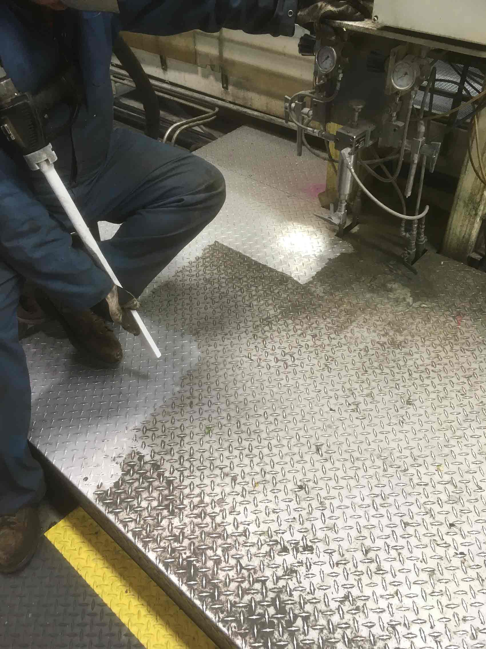 Metal floor cleaning before